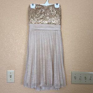 Short, strapless, gold homecoming/formal dress